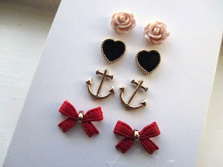 H&M earrings, roses, black hearts, anchors, and red bows.