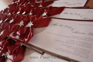 Luxurious red ribbon starfish wedding invitation