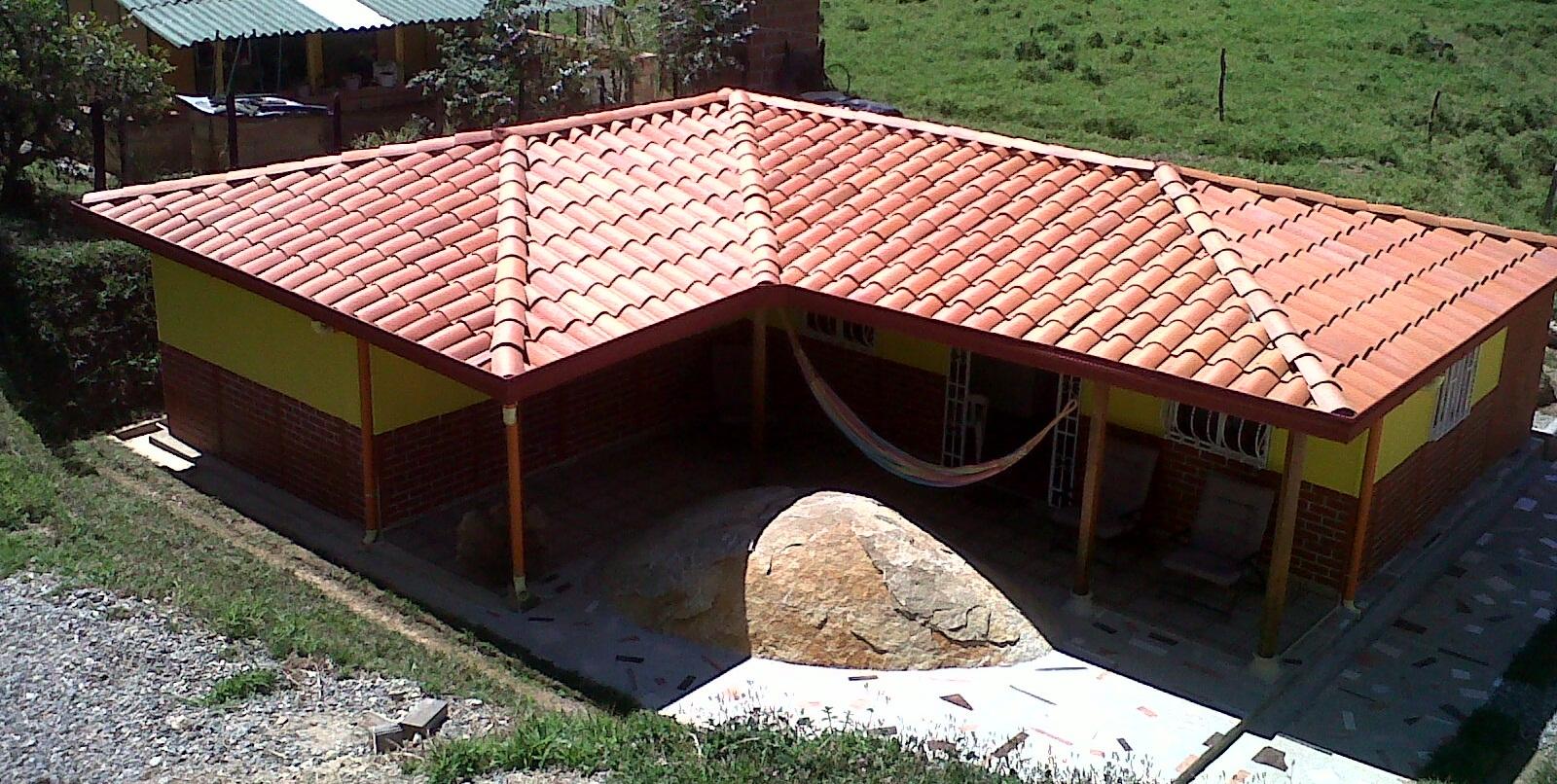 Casas prefabricadas casa real agosto 2013 for Casas techos cuatro aguas