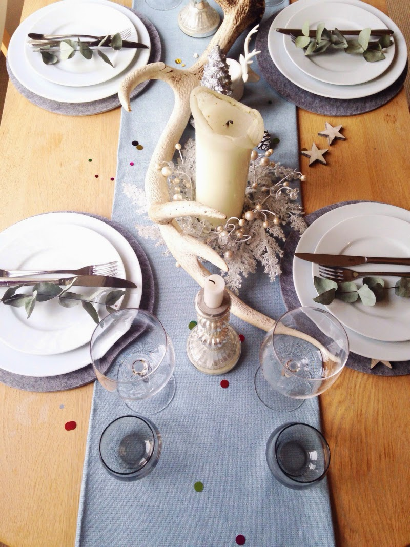 Christmas decorations on table for dinner party