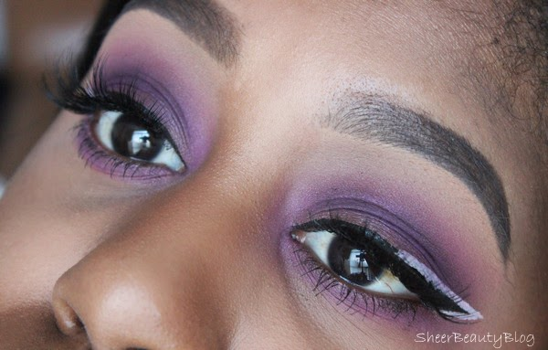 purple eye makeup with white eyeliner