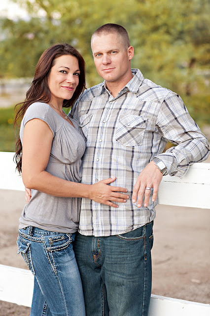 Husband and wife pose for a couple portrait at Tucson park