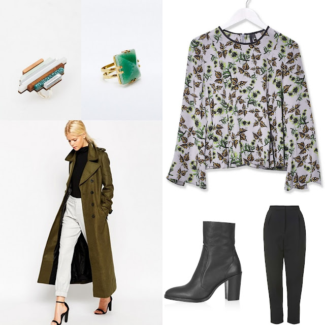 Green military coat with floral blouse, simple black trousers, ankle boots and green rings.