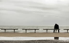 lonely man sitting on bench