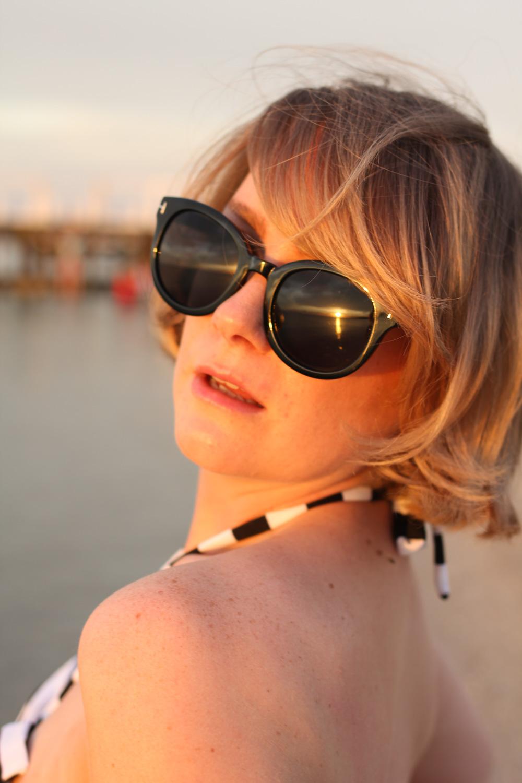 @findingfemme wears striped Bikiniboo high waisted bikini at the beach.