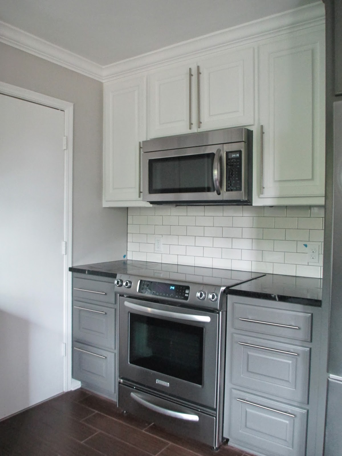 Benjamin Moore on the lower cabinets, and white on the upper cabinets