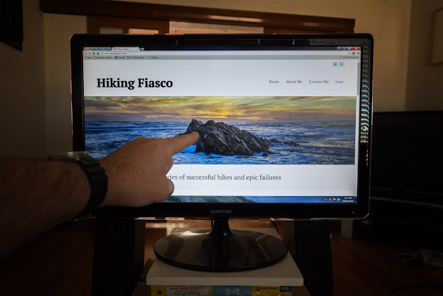 pointing at computer screen