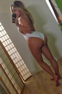 Kim Kardashian white swimuite NoFilter