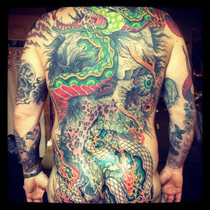 Back piece tattoo of an eyeball and skull and dragon by tattoo artist Jason Kunz for Triumph Tattoo