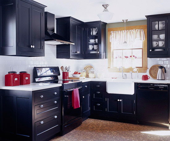 This small kitchen aims to be big with dramatic flourishes of black
