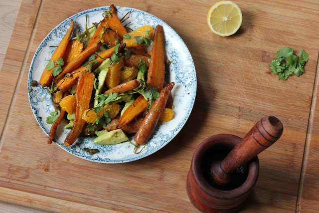 The lightly warm roasted carrots combine with orange, avocado and ...