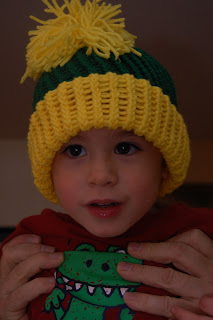 boy wearing a knit mohawk hat