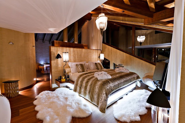 Picture of luxury bedroom with white carpets at night