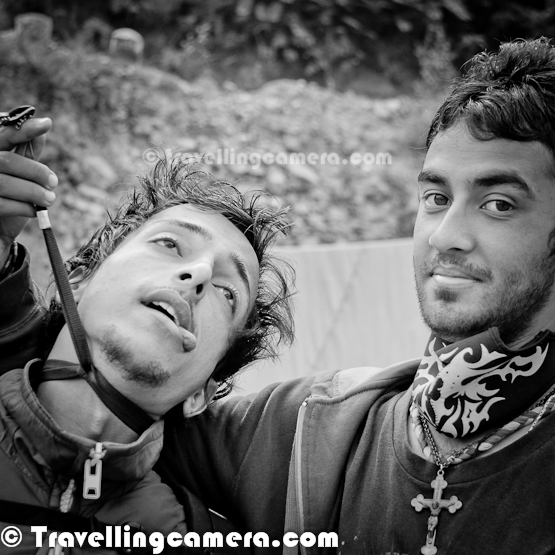 MTB moments are full of adventure, passion and Fun. This Photo Journey is trying to share some light moments of this beautiful journey of 8 days in Himalayas... The very first photograph shows two friends Parikshit and Kshitiz, who are trying to keep them happy after no sleep last night. Let's not talk about the reasons behind no sleep :)Here Mr. Saurabh and Rohit are dancing in dense forests of Jalori-Jot. Most of the times on Himachali Folk Songs... Rohit is really very interesting person and he was quite popular among Volunteers, Marshals and Media folks. He is the one who actually made Sarahan evening more interesting.Parikshit and Sachin during morning of 4th day in chilling Himalayas... These are some of the warm-up activities for every morning of MTB Himalayas...At times, people jump up on jeep-roof to have more adventure... Karan and Vedant having fun on car-roof...At times, volunteers get bored while waiting for riders to cross. So it's responsibility of Photographer to entertain them and keep the energy high !! KK, Aneesh, Gagan and Arjun flying high in Hiamayalas...The most energetic person and Chief Bike Marshal, Aneesh Airborne Awasthi...No one needs to motivate Rohit for some entertainment. He is all rounder and always full of energy. Here he is trying to entertain volunteers waiting for rides near Narkanda...It's in our hands to make India Incredible !!!Fun time on one of the highest peaks around Shimla !!! It's Hatu Peak, which is quite popular among Bikers and Adventure Lovers... Many bollywood movies are shot here...I know MTB is Cycling event, but we meet some marvelous bikers who can ride their bikes on any hill and no path is required. They know how to make their own paths...Here is another example of adventurous spirit ! It was shot on a hill with no road and Aneesh drove his bike upto halfway. Most of us were trekking. In above photograph he is trying to cross a small bridge, which is tree lied down horizontally..Have you seen this kind of sport, where brand new cycle tyre is used in this way... Nirgala ensuring that her cycle and it's different components are fit for next day...Evening fun with local musicians and singers !!Modeling in Himalayas ! Arjun is all set for his photo-shoot...Daring people also dive into chilling water of Himalayan rivers/streams. btw, it's fun to take bath in these chilling rivers during noon time...We shall keep sharing few more photographs of MTB Himalayas !!!