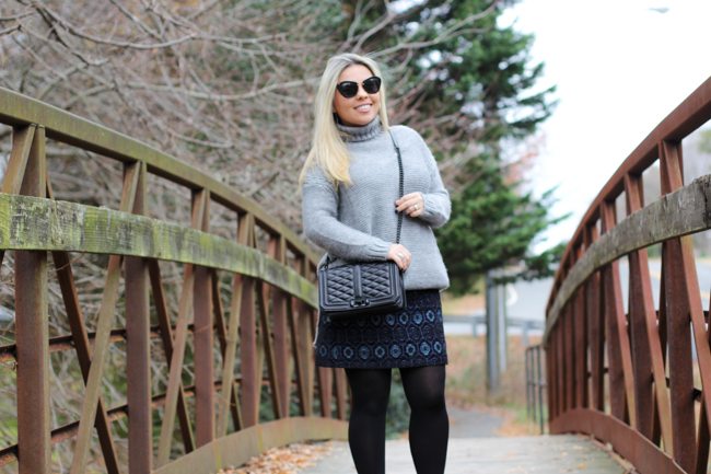 grey sweater and blue patterned skirt