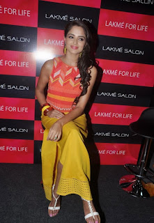 Asmitha Sood in lovely Small Orange Sleeveless Top and Yellow Trousers at Lakme Salon Launch