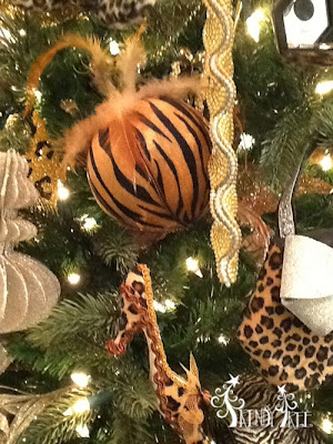 http://www.trendytree.com/raz-christmas-and-halloween-decor/raz-amimal-print-ball-christmas-ornament-set-of-2.html