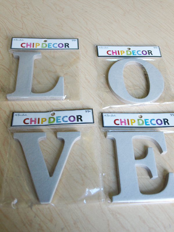 i started with these chipboard letters from hobby lobby found near the scrapbook supplies you could also cut a letter from sturdy cardboard or use a