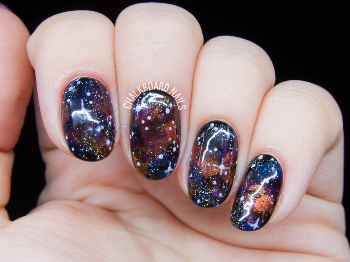 Jewel-toned galaxy nails by @chalkboardnails