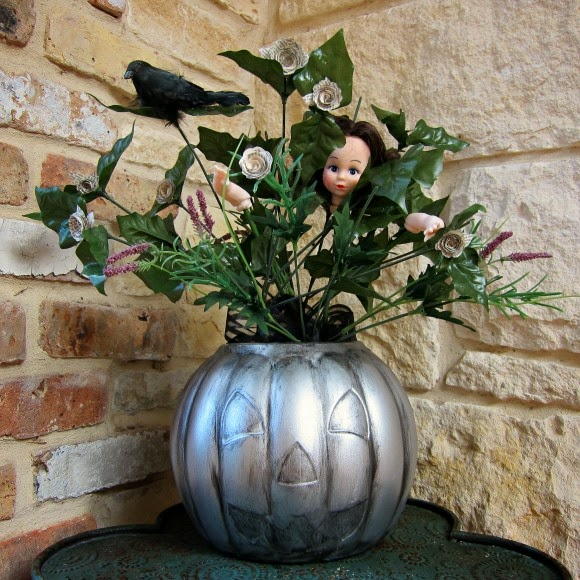 http://dollarstorecrafts.com/2013/10/turn-a-dollar-pumpkin-into-a-faux-pewter-halloween-centerpiece/