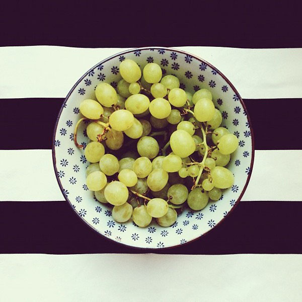 grapes in a bowl, on black stripes