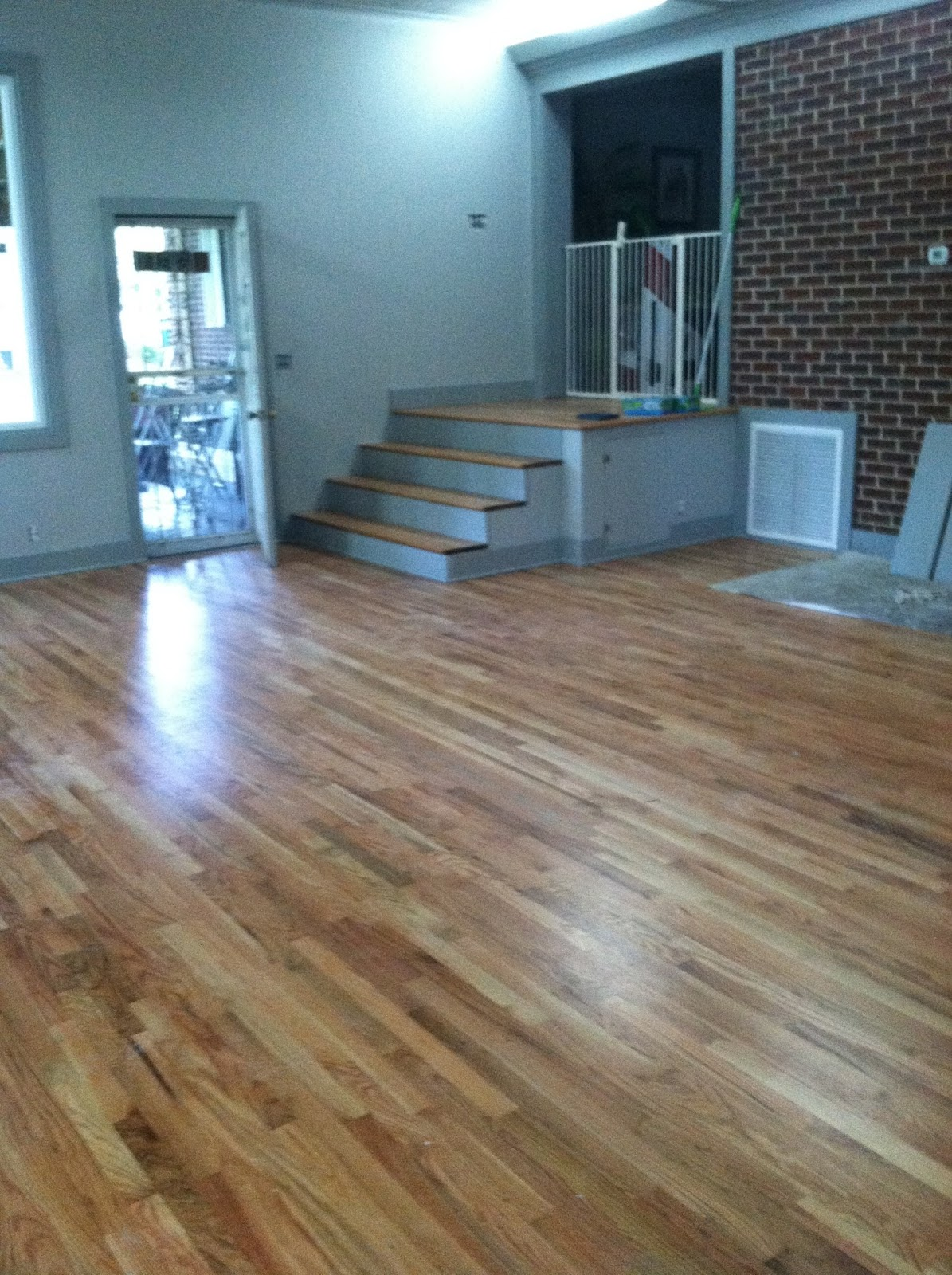 Country flooring direct sand and finish red oak installed Hill country wood flooring