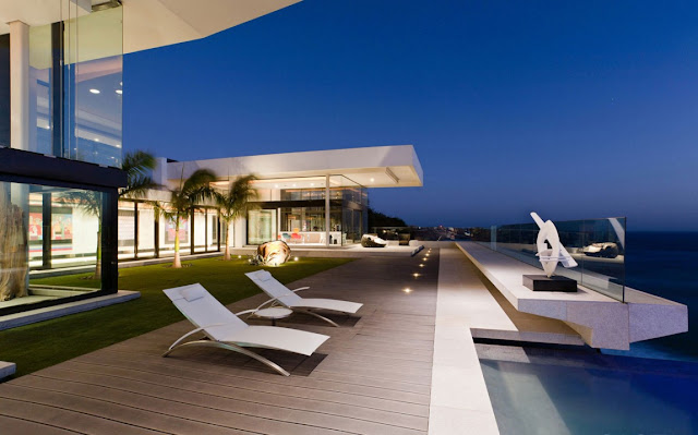 Picture of modern white garden furniture on the terrace by the pool