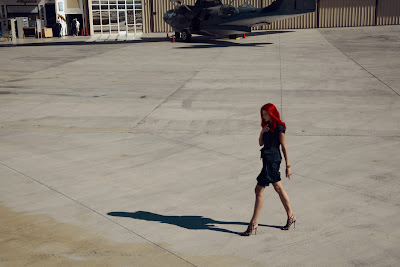 woman walking through airport, fashion photography, top fashion photographers nyc