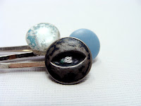 hair accessories in blues and greys made with vintage buttons