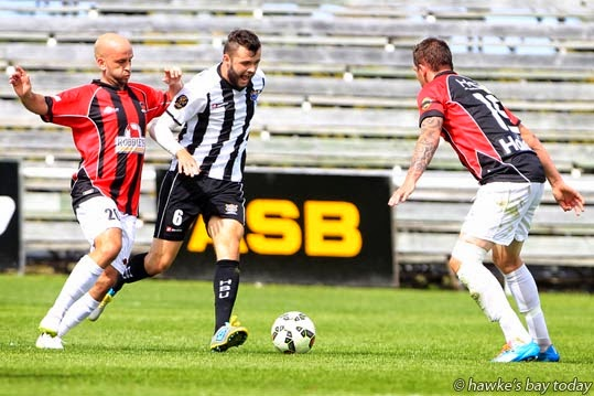 L-R: Stuart Kelly, Canterbury United; Ryan Tinsley, Hawke's Bay United - HBU won 5-2, soccer, football at Bluewater Stadium, Park Island, Napier. photograph