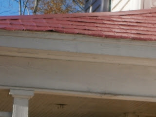 Antique tin shingles use side of shingle for roof edging