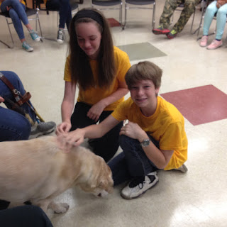 summer day campers visiting with guide dog Jessie