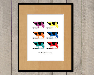 framed poster with multiple colored cows in complementary colors