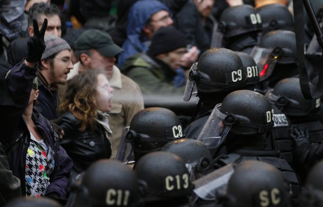 Here a police officer uses pepper spray on an Occupy Portland protester at ...