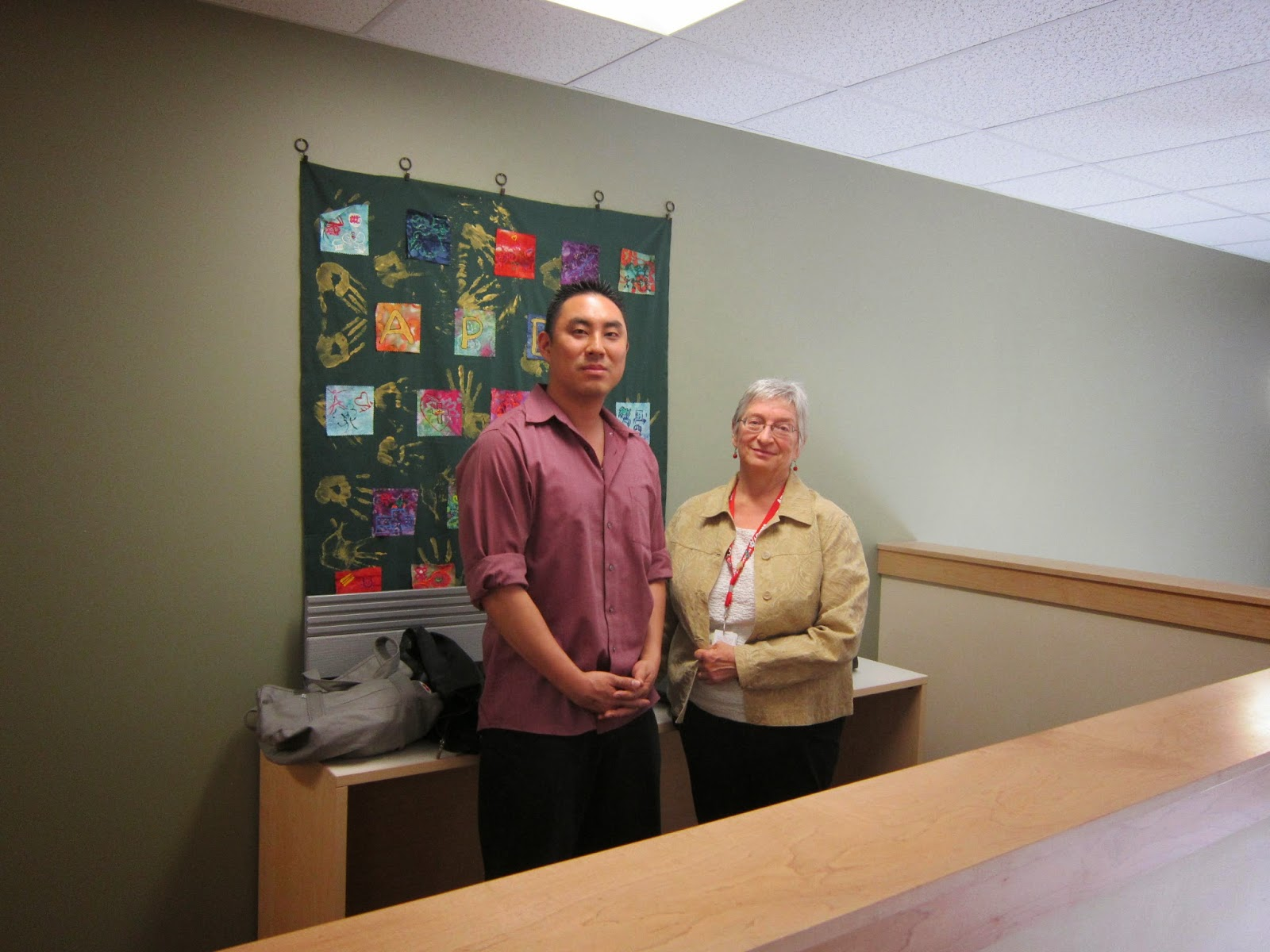 robbe sokolove stands beside member of asian pacific development center in denver