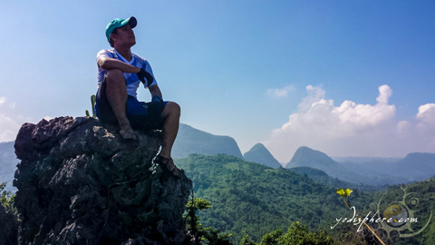 Yodi on top of Mt. Sipit Ulang with view of Mt. Pamitinan and Mt. Binacayan