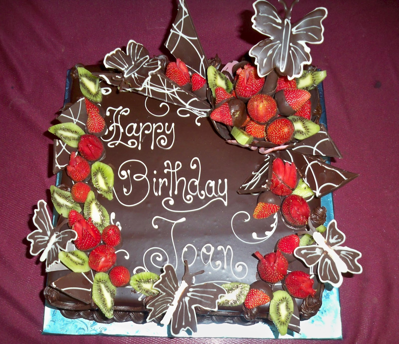 Chocolate Birthday cakes with chocolate butterflies strawberries chocolate f