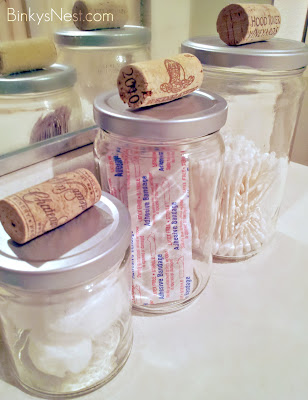 Kitchen / Bathroom Canisters made from food jars, corks and spray paint DIY on BinkysNest.com