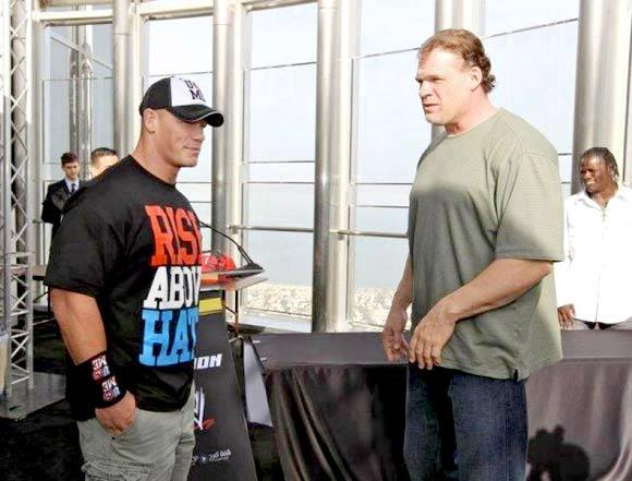 wwe events curious image of unmasked kane with john cena