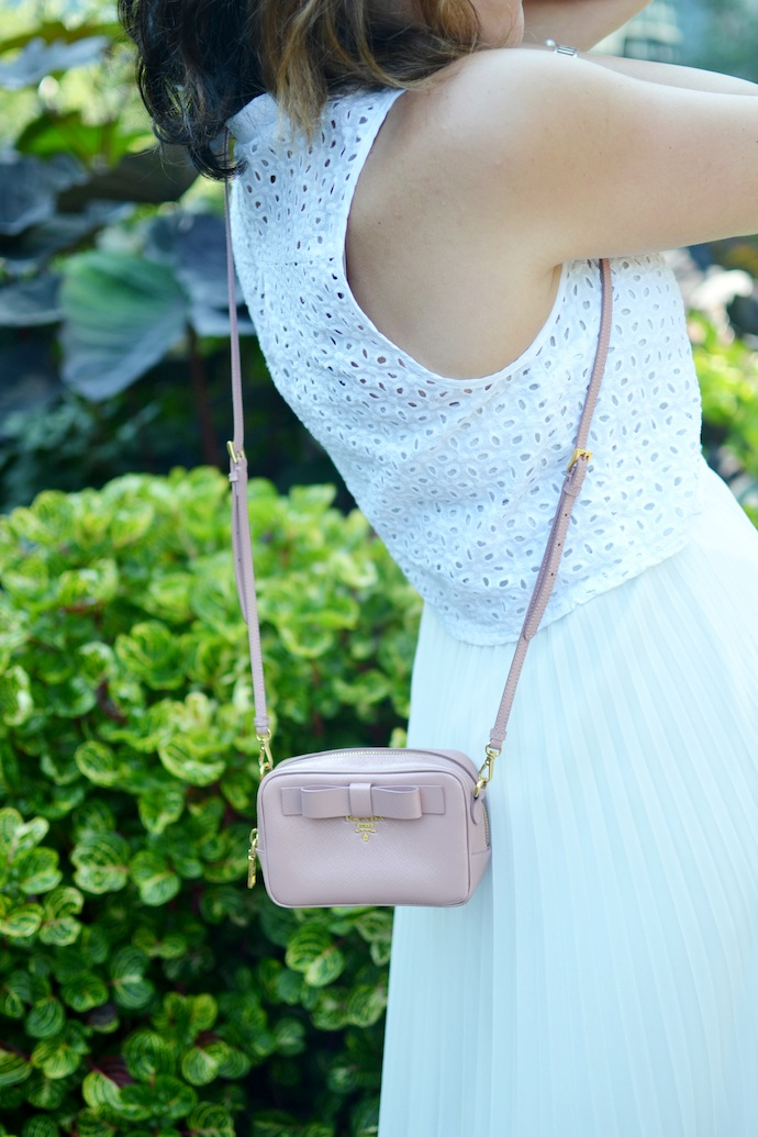 Forever 21 eyelet crop top, Aritzia Babaton Jude skirt and Prada saffiano handbag