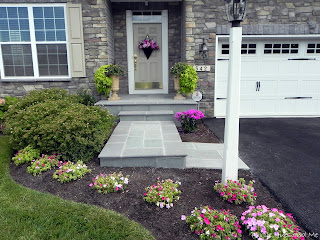 updating front porch entrance with flagstone