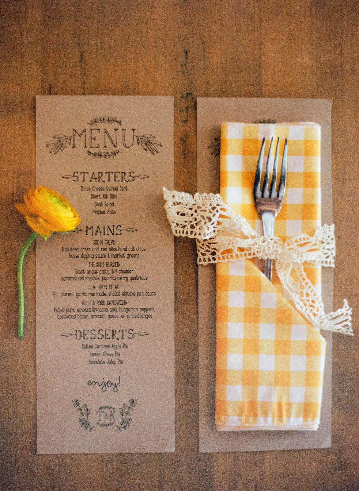 handmade kraft paper wedding menu and yellow gingham napkin tied with vintage lace and a yellow ranunculus flower for a an intimate brooklyn, new york wedding dinner