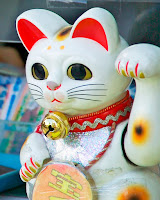 """Manekineko1003"". Licensed under Public Domain via Commons - https://commons.wikimedia.org/wiki/File:Manekineko1003.jpg#/media/File:Manekineko1003.jpg"