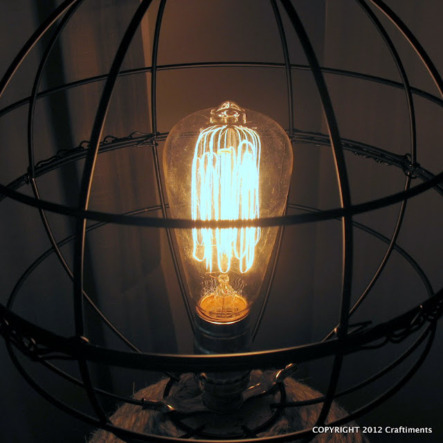 Craftiments.com:  Openwork globe shade with vintage style edison bulb