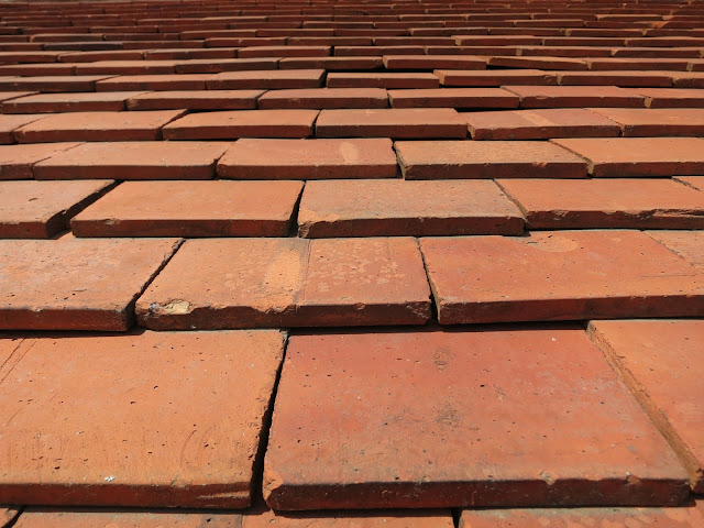 Terracotta coloured roof tiles.