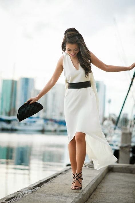 White Silk crepe dress with high heels and black hand bag