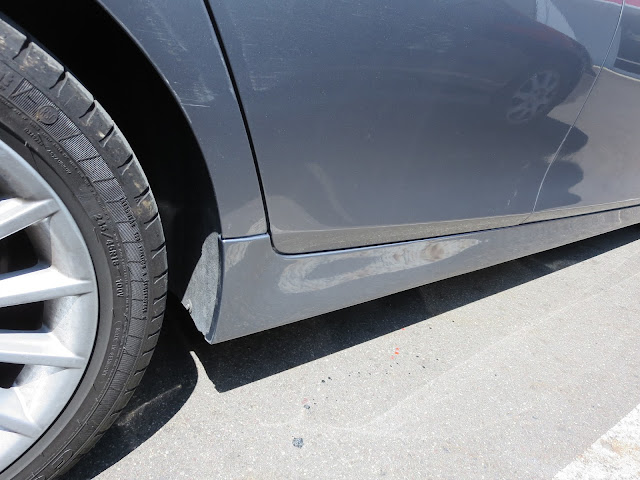 BMW after paint scrapes repaired and painted at Almost Everything Auto Body