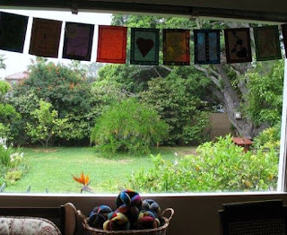 window with prayer flags and fabric balls