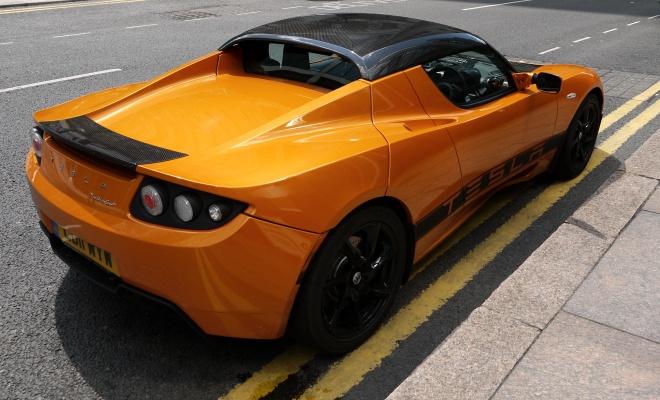 Orange Tesla Roadster Sport seen from the rear