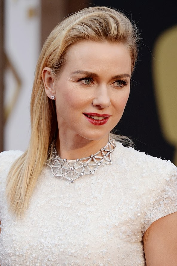 Naomi Watts on the red carpet with a soft quiff and sleek hair